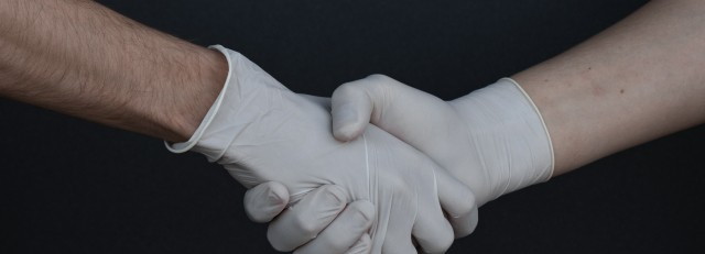 people-shaking-hands-in-latex-gloves-3959482.jpg